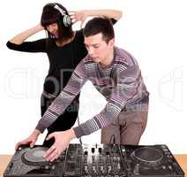dj and girl playing music and dancing
