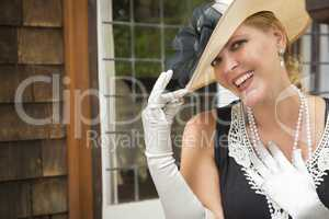 Attractive Woman in Twenties Outfit on Porch of Antique House