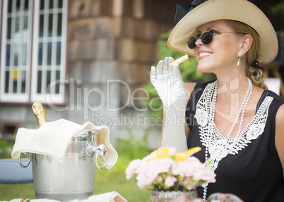 Twenties Dressed Woman Eating and Drinking Champagne At Outdoor