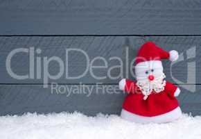 Merry Christmas - Santa Claus on wooden background