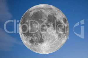 Full moon over blue sky