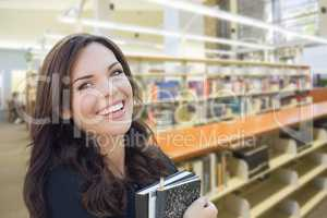 Mixed Race Girl With Books in the Library