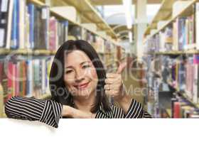 Hispanic Woman with Thumbs Up On White Board in Library