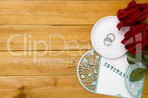 Invitation to the wedding with wedding rings