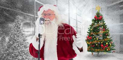 Composite image of santa claus is singing christmas songs