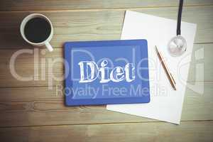 Diet against high angle view of digital tablet and document with