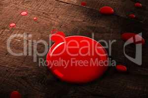 A red bauble paint splash