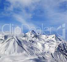 Winter snowy mountains in windy day