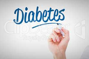 Diabetes against businessmans hand writing with marker
