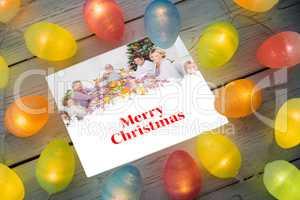 Composite image of christmas lights on table