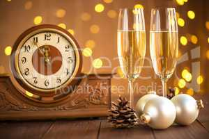 Christmas card. Glasses of champagne on New Year's Eve on the stand an ancient clock