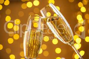 Two champagne glass on christmas bokeh background