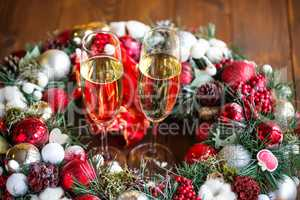 Two champagne glass on christmas background