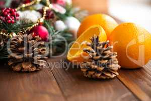 Oranges on the Wood Table with Christmas Background