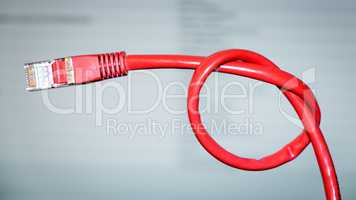 red networking cable with a knot