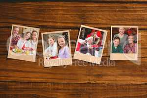 Composite image of instant photos on wooden floor
