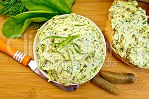 Butter with spinach and herbs in bowl on board top