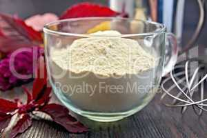 Flour amaranth in glass cup on board