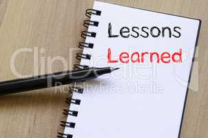 Lessons learned write on notebook