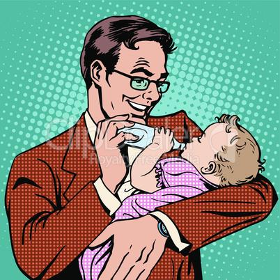 Happy father feeding newborn baby with milk