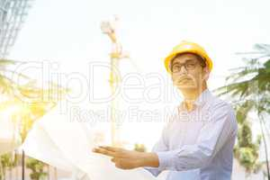 Asian Indian male contractor engineer inspecting at site