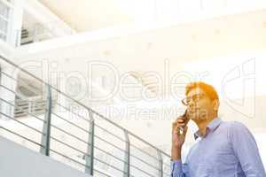 Indian businessman calling on smartphone