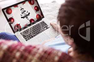 Composite image of pregnant woman using her laptop