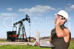 oil worker with laptop and phone