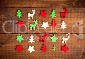 Christmas decoration on the wood background. Collection of xmas miniatures.