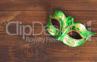 female carnival mask with wooden background