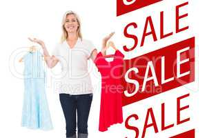 Composite image of pretty shopping blonde choosing a dress