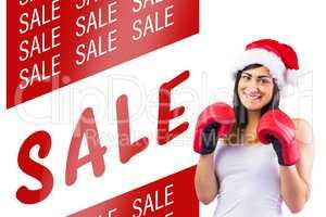 Composite image of festive brunette in boxing gloves