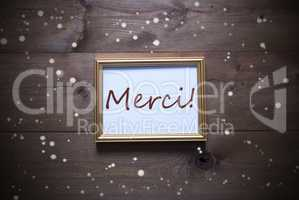 Golden Picture Frame With Merci Means Thank You And Snowflakes
