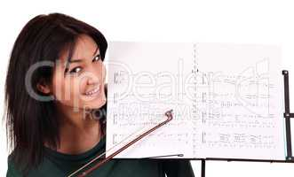 girl and notebook for musical notes