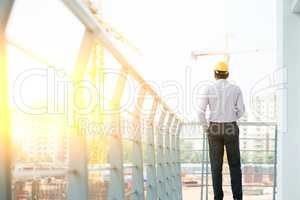 Back side of Asian Indian male site contractor engineer