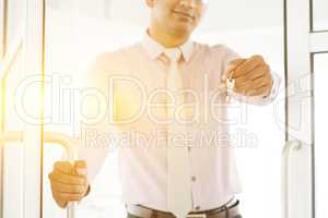 Asian Indian people holding office key