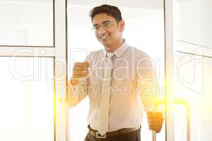 Indian man holding office key