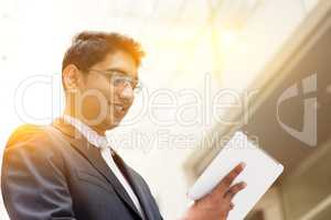 Asian Indian businessman using tablet computer