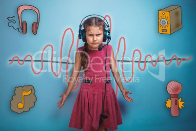 girl in headphones throws up his hands toward the sound wave mus
