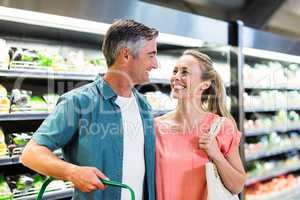 Smiling couple at the supermarket