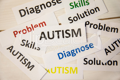 Autism words on wooden table