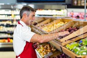 Seller filling vegetables box