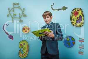 Boy in a business suit student working on the tablet keen icons