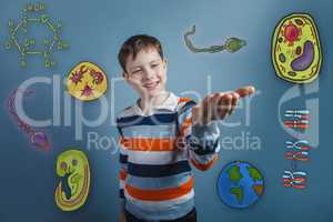 Boy smiling and holding in the palm of icons biology education f