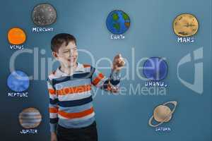 Teenage boy laughing and holding a finger of the planet of the s