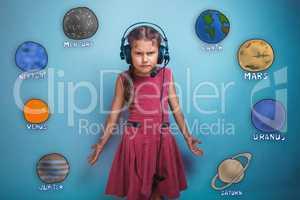 Teenage girl in headphones surprised furrowed face of the planet