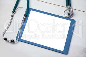 Tablet and stethoscope on desk