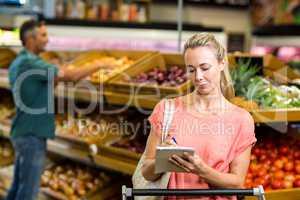Pretty woman checking grocery list
