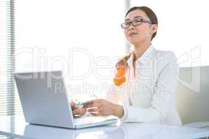Smart businesswoman using her laptop