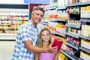 Father and daughter in the supermarket